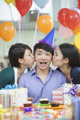 Male Kissed By Two Female Colleagues — Stock Photo
