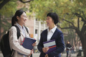 University Student and Professor on Campus — ストック写真