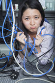 Businesswoman Frustrated by Ethernet Cord — Stock Photo