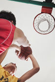 Basketball players waiting for a rebound — Stock Photo