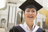 Young Graduates in Cap and Gown — 图库照片