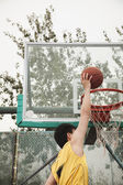 Slam dunk by young man — Stock Photo
