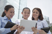 Three young businesswomen discussing outdoors — Stock Photo