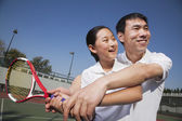 Young girl playing tennis with her coach — Foto Stock