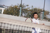 Adult man playing tennis — Stock Photo