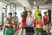 Group of young people in the gym — Stock Photo