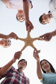 Group of Friends Holding a Starfish — Stock Photo