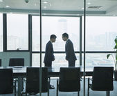 Two Businessmen Bowing to Each Other — Stock Photo