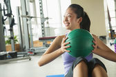 Young woman exercising in the gym — Stock Photo