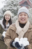Couple Holding snow balls in park — Stock Photo
