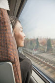 Woman Looking Out the Window of a Train — Stock Photo