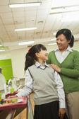 Teacher and school girl portrait in school cafeteria — Stock Photo