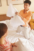 Young Couple Having a Pillow Fight — Stock Photo
