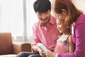 Family Looking at Picture Together — Stock Photo