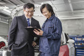 Businessman with Mechanic in Auto Repair Shop — Stock Photo