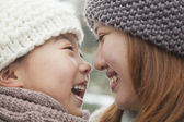 Mother and daughter nose to nose — Stock Photo