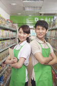 Two Sales Clerks Standing in a Supermarket — Stock Photo