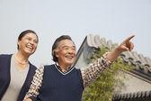 Senior couple walking outside in Beijing — Stockfoto