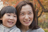 Mother and Daughter smiling in the park — Stock Photo