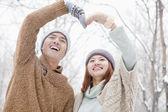 Couple making heart shape in winter — Stock Photo