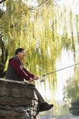 Multi-generational men fishing portrait — Stock Photo