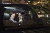 Businesswomen Working In Car Back — Stock Photo