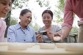 Mature people playing Chinese checkers — Stock Photo