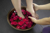 Woman's Feet in Water with Rose Petals — Foto Stock