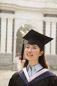 Young Graduates in Cap and Gown — Стоковое фото