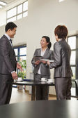Business people meeting in company cafeteria — Stock Photo