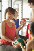 Group of young people exercising in the gym — Foto Stock