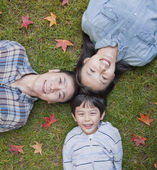 Family portrait on the grass — Stock Photo