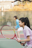 Young girl playing tennis — Stock Photo