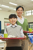 Teacher and school girl portrait in school cafeteria — Stock Photo
