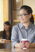 Woman at coffee shop — Stock Photo