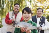 Multi-generational men fishing portrait — Stockfoto