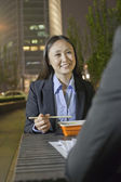 Businesswoman Having Dinner With Colleague — Stock Photo