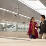Woman talking to man on railway platform — Stock Photo #36346835