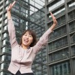 Businesswoman with arms outstretched — Stock Photo
