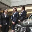 Businesswomen meeting and talking in parking garage — Stock Photo #36347709