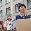 Family moving boxes into a dormitory at college — Stock Photo #36349107