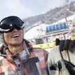 Smiling Snowboarder in Ski Resort — Stok fotoğraf