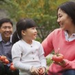 Happy family in garden — Stock Photo #36349265