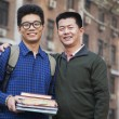 Stock Photo: Father and son in front of dormitory