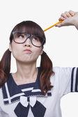 Muchacha escolar que piensa — Foto de Stock