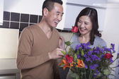 Couple with Bouquet of Flowers — Stock Photo