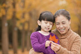 Grandmother and granddaughter in park — Stock Photo
