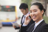 Business people walking outdoors — Stock Photo