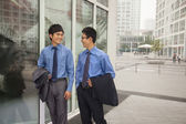Businessmen walking outside of the office — Stock Photo