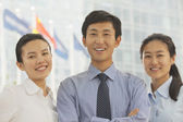 Three young business people — Stock Photo